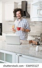 Man Eating Breakfast  Using Laptop, Man in kitchen drinking coffe
