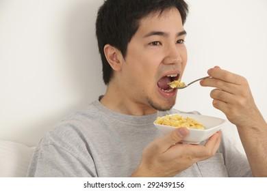 Man eating cereals