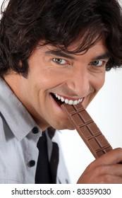 Man eating chocolate bar