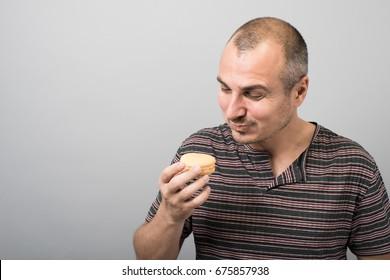 man eating cookies