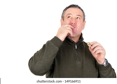 Man eating cookies and licks his fingers