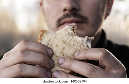 Man eating with dirty hands