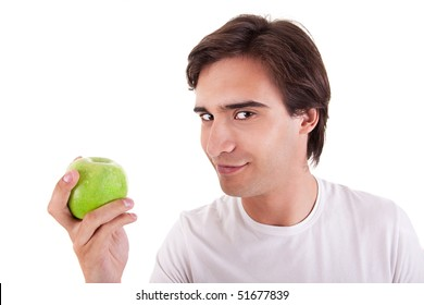 man eating a green apple, on white background. Studio shot