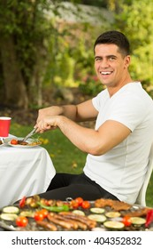 Man eating grilled meal during bbq party