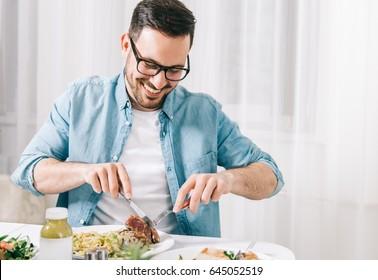 Man eating healthy food and drink detox juice