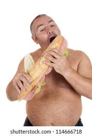 a man eating a huge sandwich