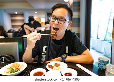 man eating a japanese grill Wagyu beef