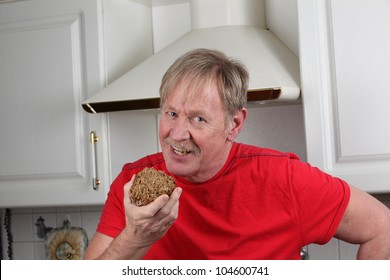 man is eating a peace of bread