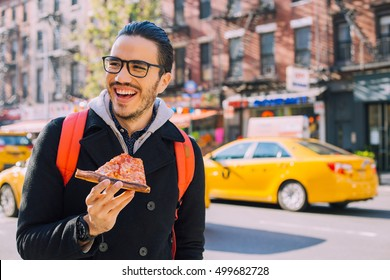 Man eating a pizza slice in New York