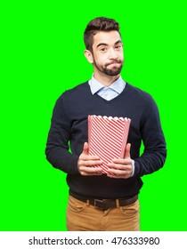 man eating popcorn