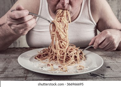 Man eating spaghetti, overeating adult.
