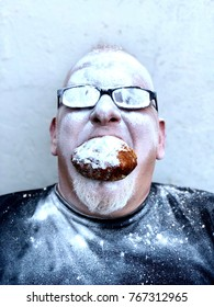 Man eating typical Dutch oliebol
