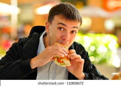 man eats a sandwich