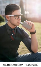 man with e-cigarette outdoors