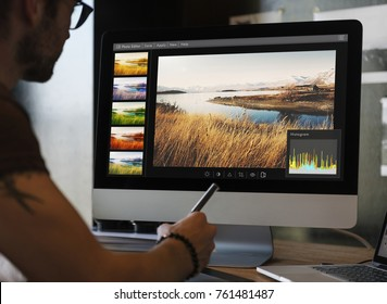 Man editing photos on a computer