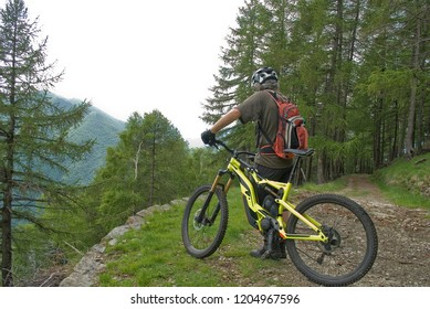 man with an electric bicycle, e-bike, ebike, mtb, observes valley, mountains, forest, summer, sport, adventure, freedom, alps, sun, cloud, Mount Legnone, Como Lake, Lombardy, Italy