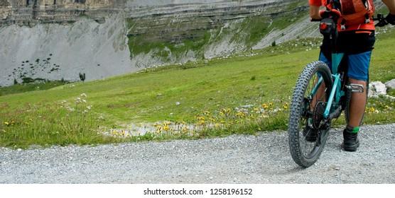 man with an electric bike, e-bike, ebike, mtb, rock, mountains, Dolomites, Madonna di Campiglio, summer, sport, adventure, alps, travel, Trentino Alto Adige, Italy