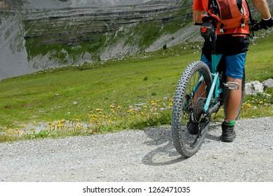 man with an electric bike, e-bike, ebike, mtb, rock mountains, Dolomites, Madonna di Campiglio, summer, sport, adventure, alps, travel, Alps, Trentino Alto Adige, Italy