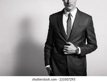 Man in elegant black suit.