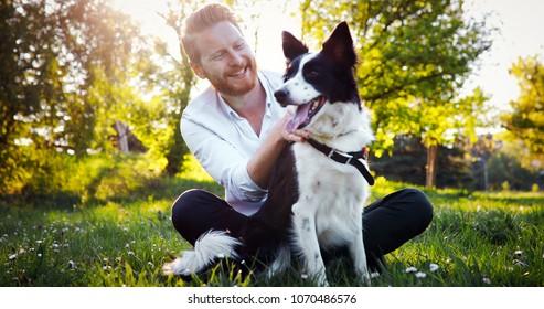 Man embracing his dog