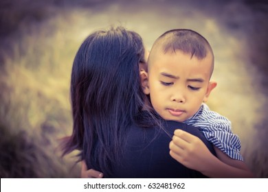 Man embracing a mother in the meadow.