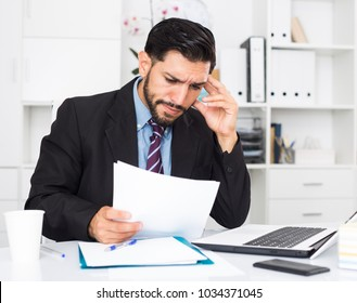 Man employee is indignant because he is having issues with project in office.