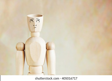 Man with an empty head. Abstract image with wooden puppet