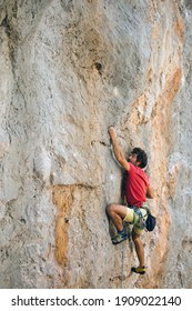 A man is engaged in extreme sports, a climber is training on Turkish rocks, strength and endurance training