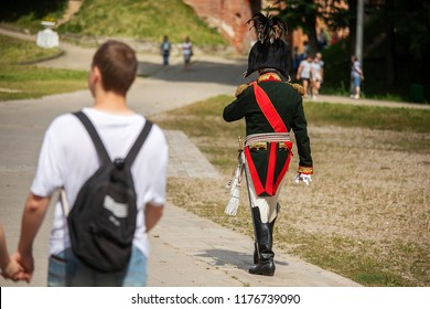 man is engaged in the reconstruction of the battle of the Napoleonic wars, the officer of the French army of the 19th century strolls among people in the city park before the battle