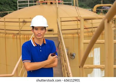 Man engineer  checking level oil tanks.