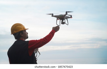 Man engineer flying with drone - Video surveillance and industrial ispection concept - Focus on hand