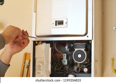 Man engineer and gas heater. Repair and work scene.