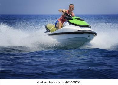Man enjoy driving jetski on the ocean