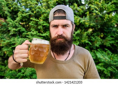 Man enjoying beer in summer. Alcohol and bar concept. Creative young brewer. Craft beer is young, urban and fashionable. Distinct beer culture. Hipster brutal bearded man hold mug cold fresh beer.