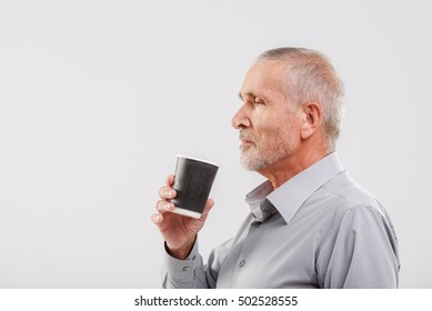 man enjoying beverage isolated on gray