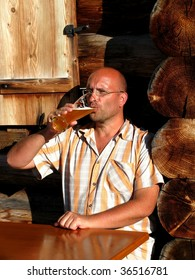 Man enjoying a fresh wheat beer on a alpine hut