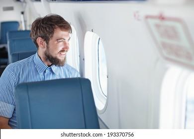 Man enjoying his journey by airplane