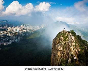 Man enjoying Hong Kong city view from the Lion rock aerial view