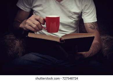 Man Enjoying Tea While Reading
