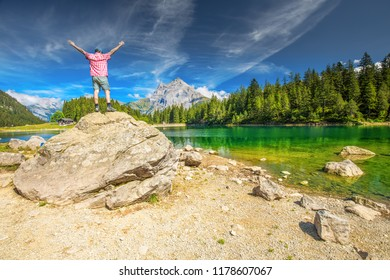Man enjoying view of Arnisee with Swiss Alps. Arnisee is a reservoir in the Canton of Uri, Switzerland, Europe.