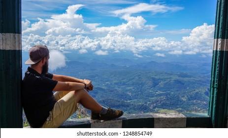 Man enjoying view at Lipton Seat in Sri Lanka