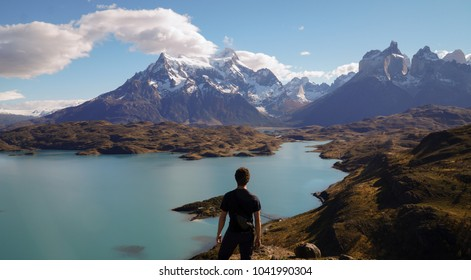 Man enjoying the view from Mirador Pehoe towards the Mountains in Torres del Paine, Patagonia, Chile.