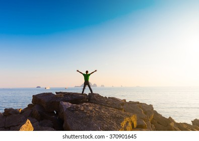 Man enjoying view nature in sea. Outstretched arms fresh morning air summer