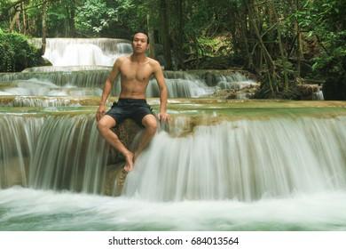 A man enjoying waterfalls in deep forest