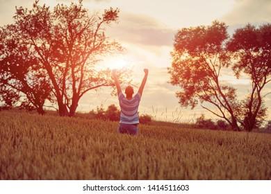 Man enjoying in wheat field. Nature concept.