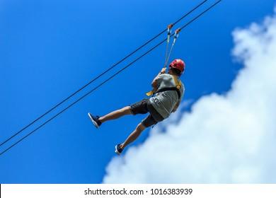 Man enjoying Zipline adventure in Sabah Borneo, Malaysia
