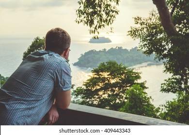 Man enjoys balcony view