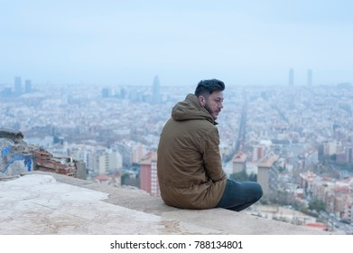 a man enjoys the view at the bunkers of El Carmel, a famous spot in Barcelona