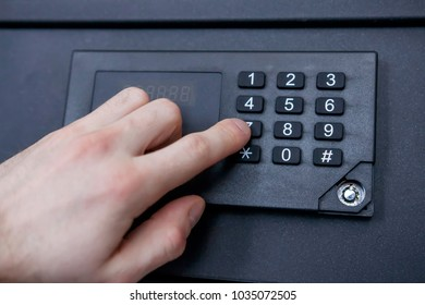 man enters code from safe close-up. Hand, safe, numbers. Safely store money and jewelry at home