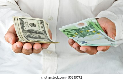 Man With Euro And Dollars